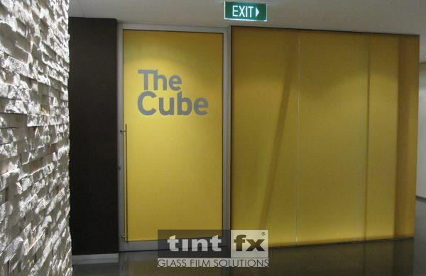 Metamark Frost and Milk Frost Printed Yellow Film with Graphic Cut - The Cube - World Square Building, TintFX