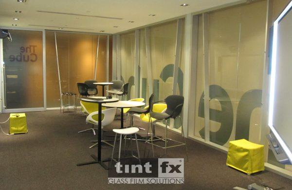 Metamark Frost and Milk Frost Printed Yellow Film with Graphic Cut - The Cube - World Square Building